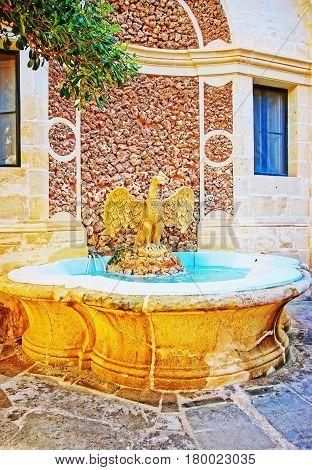 Raptor Bird Fountain At Courtyard Garden Of Grandmaster Palace Valletta
