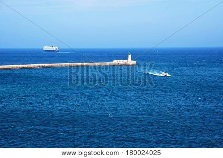 Ship At Breakwaters Of St Elmo And Grand Harbor Valletta