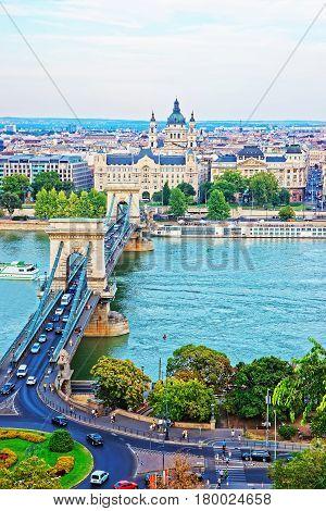 Chain Bridge Above Danube River And Saint Stephen Basilica Budapest