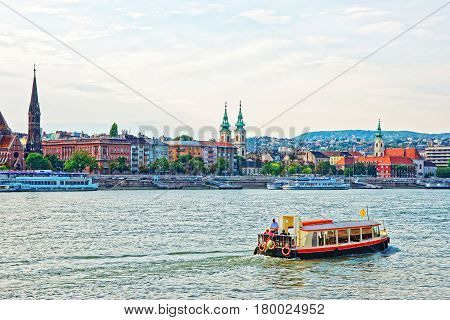 Ferry And Buda City With University Church Steeple At Danube