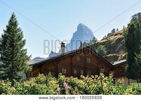 Traditional Swiss Chalet In Zermatt With Matterhorn Summit