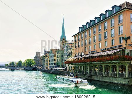 Fraumunster Church And Ferry At Limmat In Zurich Swiss