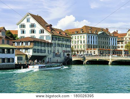 Historical Building With Paintings At Limmat River Quay Zurich