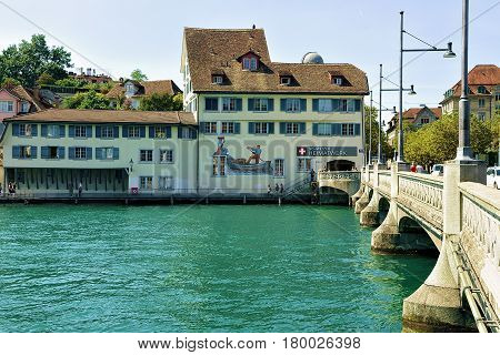 Historical Building With Paintings At Limmat River Quay In Zurich