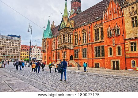 Tourists At Old Town Hall Of Market Square Of Wroclaw