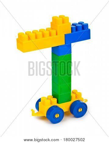 Toy construction hoisting crane isolate on white background