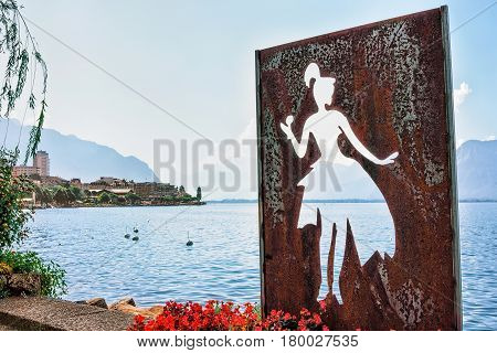 Figure Of Woman At Embankment Of Geneva Lake In Montreux