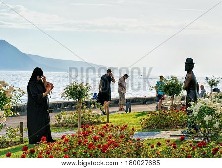 People At Charlie Chaplin Statue At Geneva Lake Vevey
