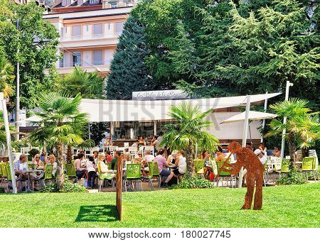 People At Open Air Cafe At Geneva Lake At Montreux