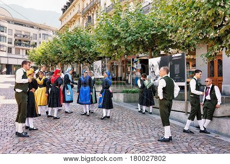 People In Traditional Costumes On Market Square In Montreux