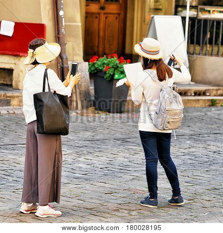 Asian Women Tourists In Kramgasse Street In Bern