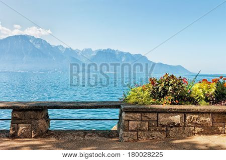 Bench And Flowers Blooming At Embankment Of Geneva Lake Montreux