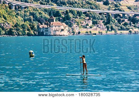 Girl Standing On Standup Paddle Surfing Geneva Lake Montreux