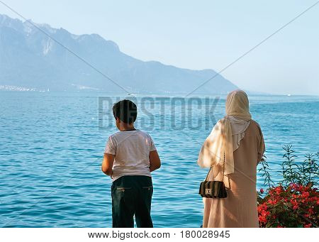 Mother And Son At Embankment On Geneva Lake In Montreux
