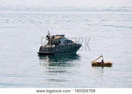 Cruise Ship And People In Catamaran On Lake Geneva Lausanne