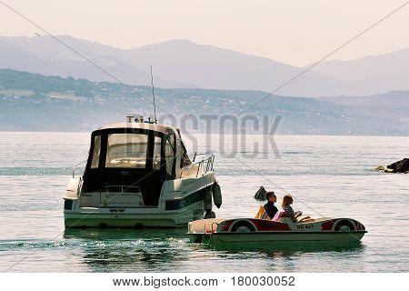 Motor Boat And People In Catamaran On Lake Geneva Lausanne