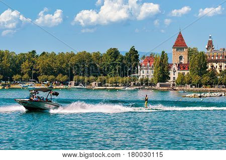 Motorboat With Man Wakeboarding On Lake Geneva Near Ouchy Lausanne