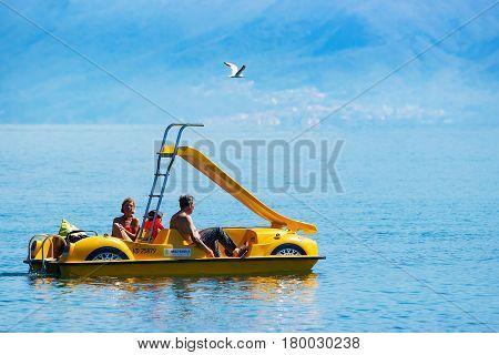 People In Catamaran At Geneva Lake In Lausanne