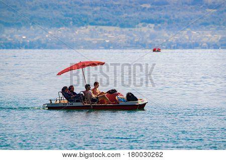 People In Catamaran In Geneva Lake In Lausanne