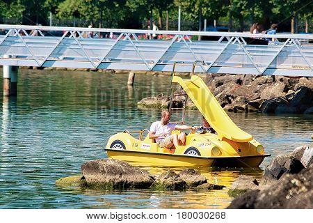 People In Catamaran On Lake Geneva In Lausanne