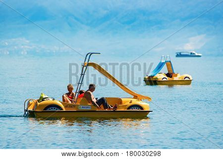 People In Catamarans In Lake Geneva In Lausanne