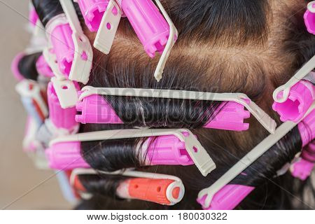 senior woman with the hair roller back
