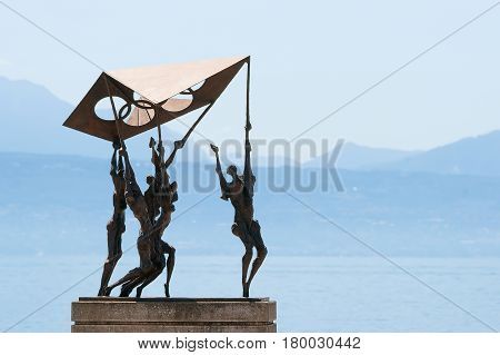Sculpture Of People Carrying Olympic Flag In Olympic Park Lausanne