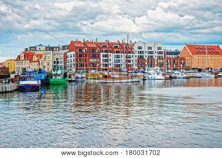 Old Port With Boats At Waterside In Motlawa River Gdansk