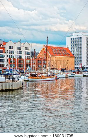 Old Port With Boats At Waterside Of Motlawa River Gdansk