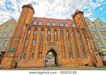 St Mary Gate On Embankment Of Motlawa River In Gdansk