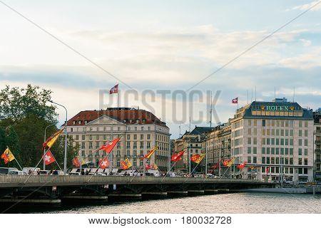 Geneva Lake And Mont Blanc Bridge Swiss Flags People