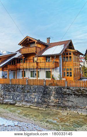 Alps Partnach River And Wooden Chalet In Garmisch Partenkirchen