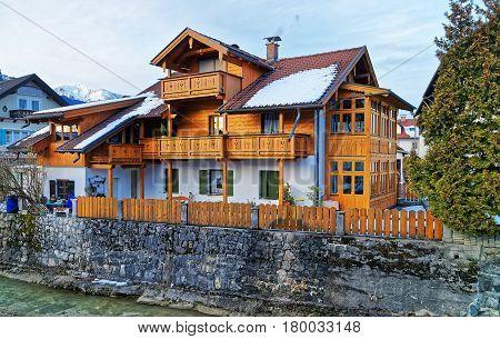 Alps Partnach River And Wooden Chalet In Winter Garmisch Partenkirchen