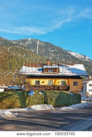 Street With Chalet And Alps Winter Garmisch Partenkirchen