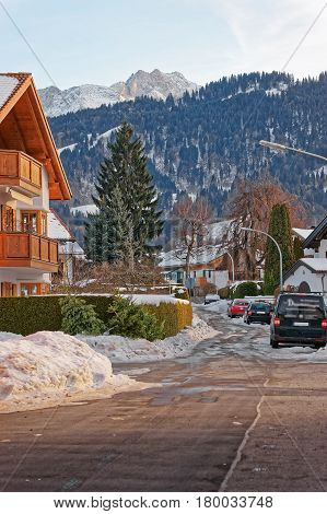 Street With Chalets And Alpine Mountains At Winter Garmisch Partenkirchen