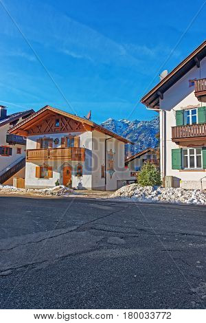 Street With Chalets And Alps In Winter Garmisch Partenkirchen