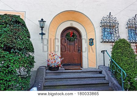 Wreath Decorated For Christmas At Doorway In Garmisch Partenkirchen