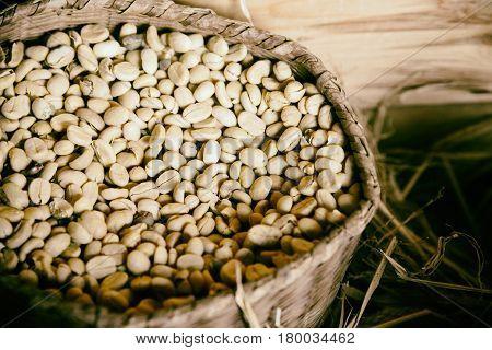 Coffee beans background vintage style iin wooden gunny bag and wooden box