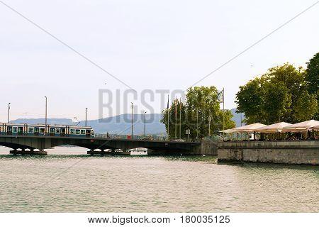Limmat River And Quai Brucke Bridge In Zurich