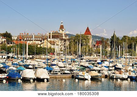 Lausanne Switzerland - August 26 2016: Marina with yachts on Lake Geneva in Lausanne Ouchy fishing village in Switzerland