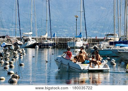 People In Yacht At Marina On Lake Geneva In Lausanne