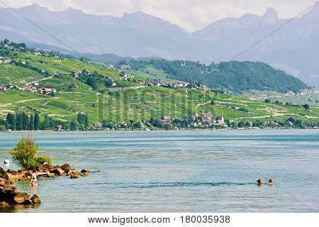 People Swimming And Sunbathing At Lakefront Lausanne