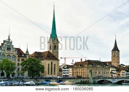 Saint Peter And Fraumunster Church At Limmat River Quay Zurich