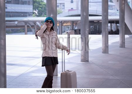 Asian Travel Woman Wearing Sweater Coat, Blue Yarn Hat With Luggage, Calling Phone At Shopping Busin