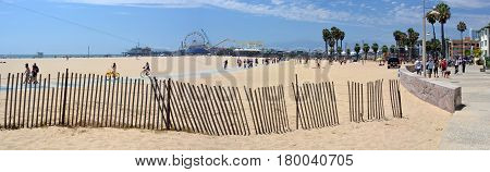 Los Angeles USA - July 14 2013: Panoramaic View of Santa Monica Beach Pier & Boardwalk on a hot Summer day.