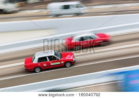 Taxis On The Streets Of Hong Kong With Motion Blur