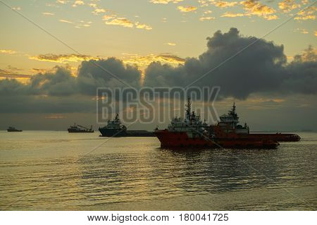 Labuan,Malaysia-Jan 22,2016:Silhouette of multi function offshore support/platform supply vessels during sunrise in Labuan,Malaysia.All the vessels in Labuan island,most related to the offshore Oil & Gas industry.