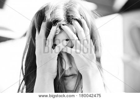 Depression. Depressed woman cover her face with her hands. Loneliness. Sadness. Sad woman.Depression concept. Black and white.