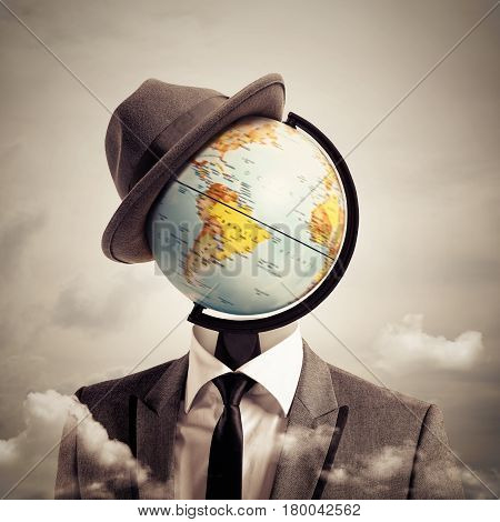 Man with a globe map as head. man globetrotter concept.
