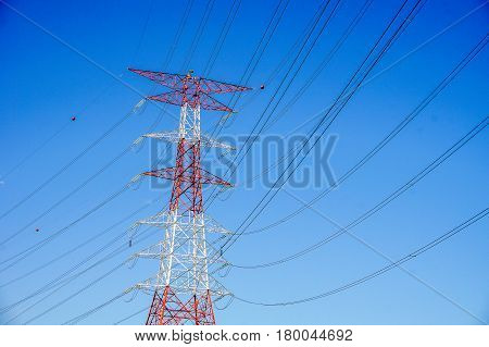High voltage power pylons tower with the blue sky background